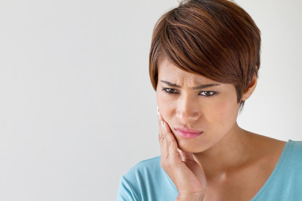woman with tooth pain | Root Canals in Dillon CO | Summit Dental Group