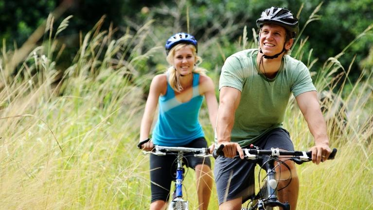 couple on a bike ride | Teeth Whitening in Dillon CO | Summit Dental Group